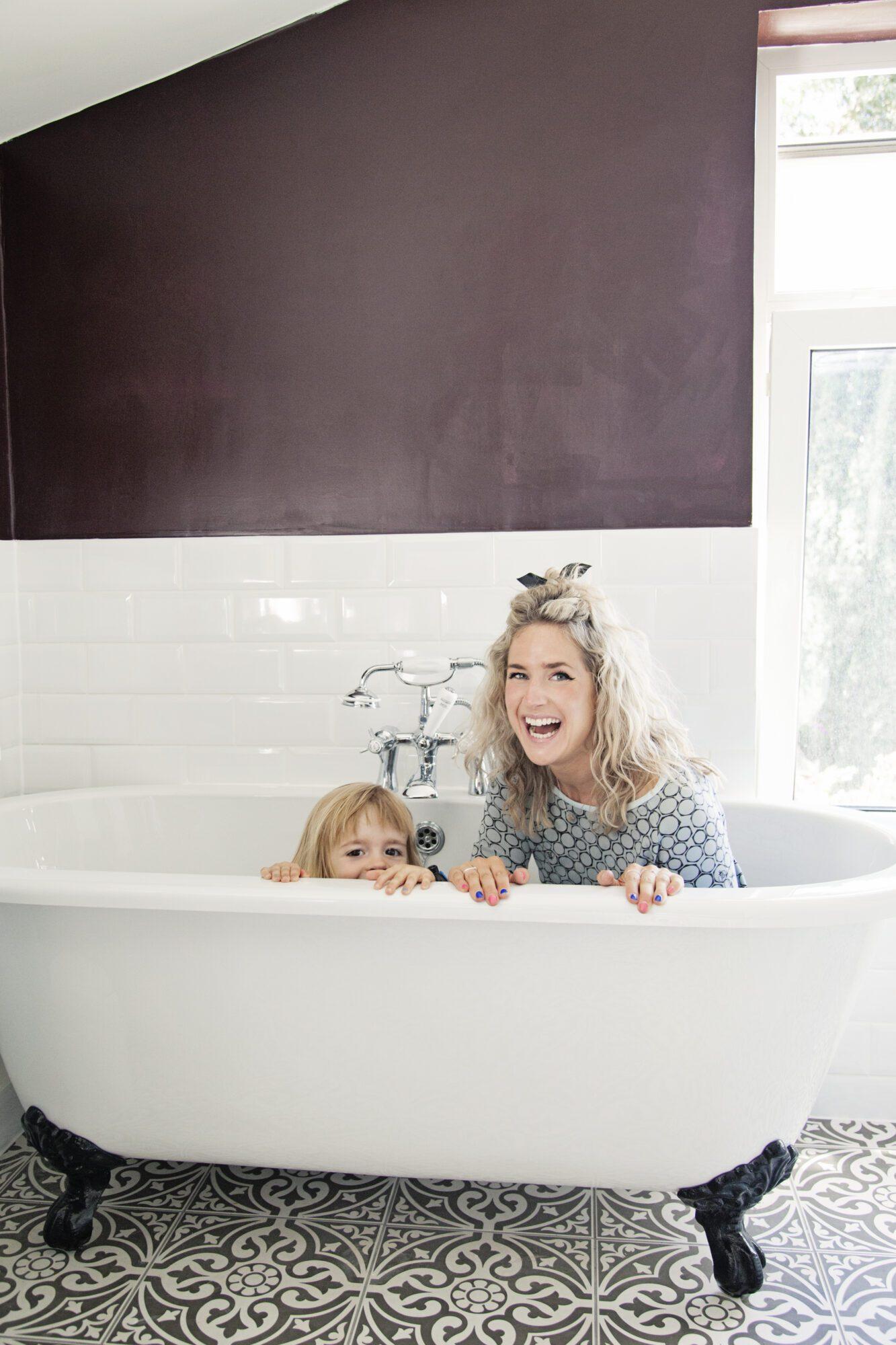 Anna Whitehouse, aka Mother Pukka and Matt Farquarson, aka Papa Pukka, with daughter Mae at their home in Leyton.